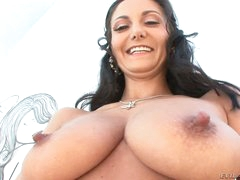 Dark haired curvy woman Ava Addams shows off her astonishing big jugs and big bubble ass. Man behind the camera is Mike Adriano. That guy touches her astonishing body!