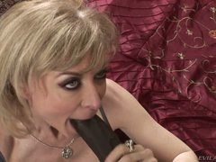 Nina Hartley is a good looking busty mature slut that is hungry for big dark dick. She takes nice size dark sausage in her experienced mouth with big desire.