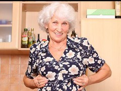 Grey haired grandma bonks her unshaved twat with a toy after making cookies