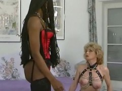 Ebony babe ties up her slave and takes care of the two cocks pounding her