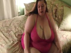 Very big women strips down to her panyhose and then shows big ass